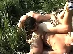 Twinks giving a kiss and smoking on grass