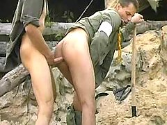 Tight anal act of love with cumshot on war