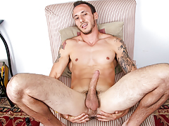 horny muscly guy with tattoos jerks off his stupendous big shlong