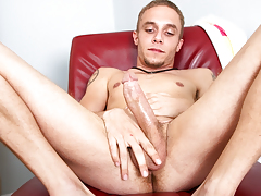 meager tattooed stud jerks off his big cock for the camera