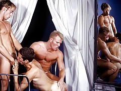 Three lascivious guys in a photo shoot run wild ! They love cock!