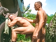 2 perspired soldiers get tired of working & blow off some steam