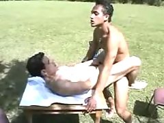 Young companion sucks and then rides his lover in park