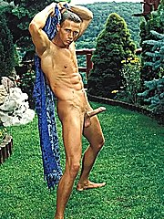 Leonardo Santangelo standing for the camera in his bathing clothing outdoors