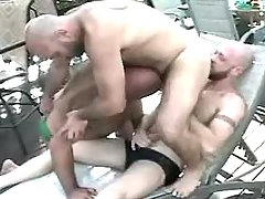 Three ripe gay guys have fun by pool
