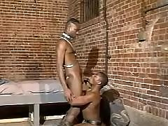 Black faggot stretches for weighty dong