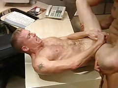Hairy stud gets subterranean anal penetration on table