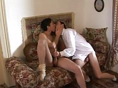 Teenage gay guys kissing on mattress