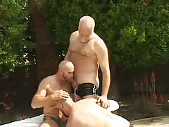 Mature  homosexual guys engulf each other outdoor