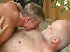 Horny stallion strokes old bear fruit outdoor
