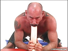 Mature unshaved twink mouths huge dildo