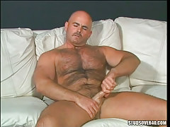 Lusty hirsute man masturbates on couch