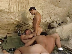 Three gay guy hunks engulf jocks in mountains