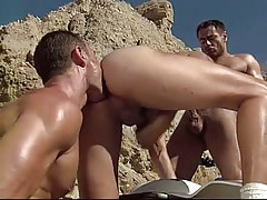 Gay hunk sucks penis and licked by boyfriend in desert
