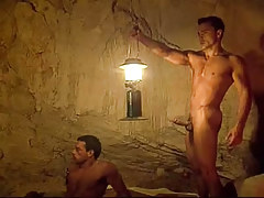 Sexy gay hunks have fun in cave