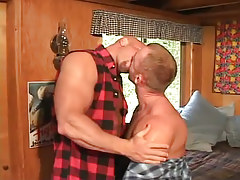 Horny gays giving a kiss in bed