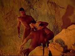 Three muscle gays suck always other in cave