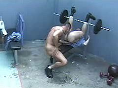Rough beefy studs do extreme oral job in prison gym